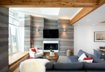 Балочно-гипсокартонный потолок в двух уровнях зонирует помещение