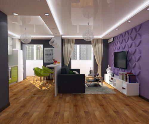Отделение жилой зоны от кухонной за счет барной стойки и формы потолка