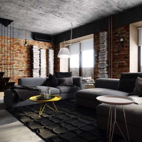 Фактурная поверхность потолка поддержана кладкой и объемным рисунком ковра диванной группы