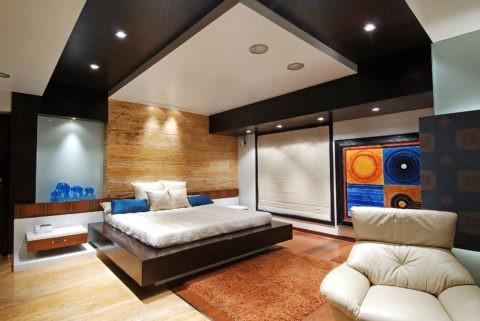 Контрастный фигурный потолок из гипсокартона в спальню добавляет пространству визуально объема